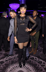 Jennifer Hudson attended the pre-Grammy gala looking hot in a super-short mesh-panel LBD and black thigh-high boots.