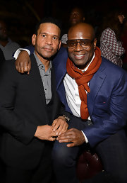 L.A. Reid's orange scarf complemented his purple suit, which he wore to to a pre-Grammy event.