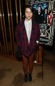 Aubrey Plaza covered up with a red and black patterned pea coat at the 'Gatsby' after-party.