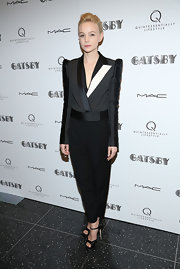 Carey Mulligan stunned yet again in this cropped tuxedo jacket with white lapels and puffed shoulders paired with tapered slacks.