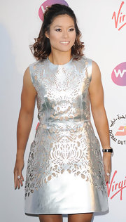 Li Na looked spectacular at the pre-Wimbledon party in a silver cocktail dress that  featured intricate laser-cut details.