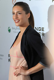 Athlete Andrea Petkovic pulled her hair back in a ponytail at the Pre-Wimbledon Party.