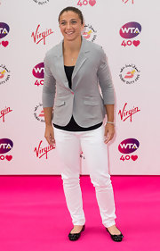 Sara Errani opted for a smart-casual look with a pair of white skinny jeans and a gray blazer when she attended the pre-Wimbledon party.