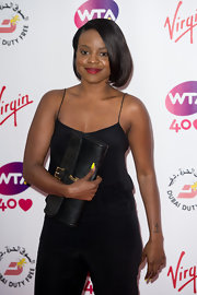 Keisha Buchanan accessorized with a classic buckled black clutch when she attended the pre-Wimbledon party.
