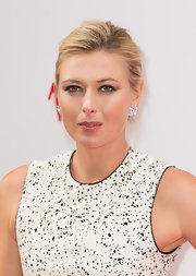Maria Sharapova opted for a classic look with this neat updo when she attended the pre-Wimbledon party.