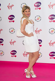 Hofit Golan complemented her simple dress with a pair of glamorous white platform sandals when she attended the pre-Wimbledon party.