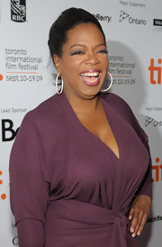Oprah Winfrey was all smiles in a lovely mauve dress and dazzling hoop earrings for the 'Precious' premiere.
