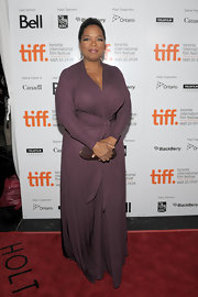 Oprah wore a burgundy wrap dress to the screening of 'Precious.' She completed her look with a sleek ponytail.