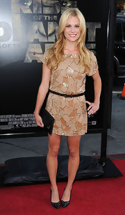 Claire Coffee donned a beaded beige mini dress that she paired with loose blonde waves.