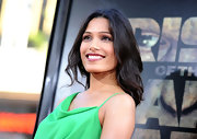Freida Pinto donned a jade green frock for the premiere of 'Rise of the Planet of the Apes.' She paired the look with a dark berry pout and tousled waves.