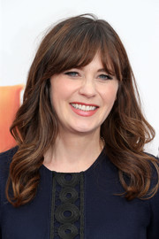 Zooey Deschanel framed her face with sweet waves and rounded bangs for the premiere of 'Trolls.'