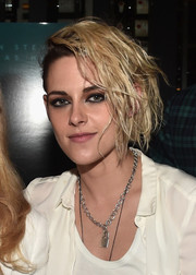 Kristen Stewart styled her outfit with a punky padlock pendant.