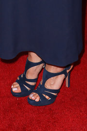 Aubrey Plaza attended the premiere of 'A Glimpse Inside the Mind of Charles Swan III' wearing chic blue strappy sandals.