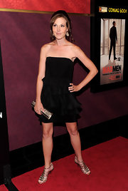 Alexis showed off her toned figure in a black strapless dress and gold strappy sandals.