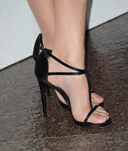 Jennifer Westfeldt opted for a classic black t-strap sandal for her evening look.