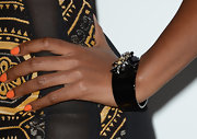 Teyonah Parris chose a black bangle with gemstone accents for her red carpet look.