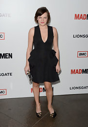 Elisabeth Moss chose a little black dress with a plunging neckline and a ruffled skirt for her red carpet look at the 'Mad Men' Season 6 screening.