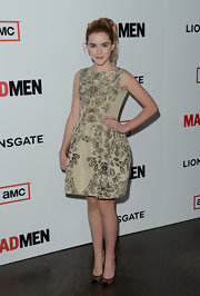 Kiernan Shipka showed she's all-grown up when she sported this gold frock with floral and diamond retro-style print.