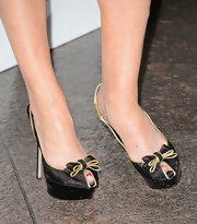 Elisabeth Moss chose feminine and flirty platform slingback with a gold and black bow for her red carpet look at the 'Mad Men' Season 6 screening.