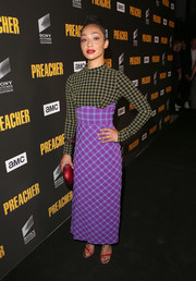 Ruth Negga attended the premiere of 'Preacher' season 3 wearing a mixed-print maxi dress by Rachel Comey.