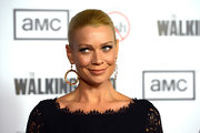 Laurie Holden dressed up her slicked back hairdo with these dangling gold circular earrings.