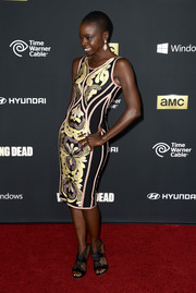 Danai Gurira paired strappy black sandals with a body-con print dress for a super-stylish look during the 'Walking Dead' season 4 premiere.