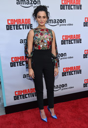 Jenny Slate went for easy elegance with this Osman jumpsuit that featured a floral-embroidered bodice and split sleeves during the premiere of 'Comrade Detective.'