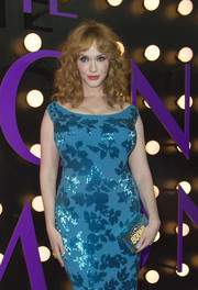 Christina Hendricks' Anya Hindmarch Boom Imperial clutch added a quirky touch to her glamorous look during the 'Neon Demon' premiere.