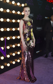 Elle Fanning was dripping in sequins at 'The Neon Demon' premiere wearing an embellished purple Dolce & Gabbana floral gown.
