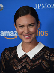 Odette Annable attended the premiere of 'Gleason' wearing her hair in a casual side-parted chignon.