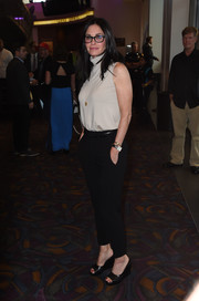 Courteney Cox kept it casual yet stylish in a sleeveless nude turtleneck and black slacks at the premiere of 'Gleason.'