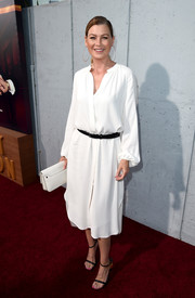 Ellen Pompeo matched her dress with a simple white leather clutch.