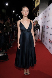 Mia Goth glammed up in a midnight-blue tea-length dress by Dior Couture for the premiere of 'Suspiria.'