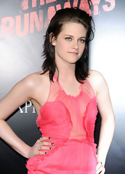 Kristen added her signature edgy messy look to her sheer pink ensemble with a teased and combed back style. Her shaggy layers created a lot of texture and the dark shade makes her jade green eyes pop.