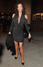 Sofia Milos looked saucy in a black faux-wrap cutout dress for the 'Beneath the Darkness' red carpet.