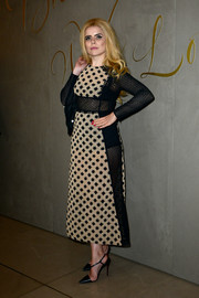 Paloma Faith looked subtly sexy in a nude and black mesh-panel dress while attending the Burberry festive film premiere.