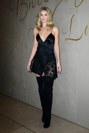 Rosie Huntington-Whiteley toughened up her look with black thigh-high boots, also by Burberry.