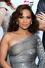 Jennifer Lopez looked stunning at her new movie premiere. She highlighted her one-shoulder dress with medium length curls.