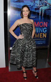 Emily Blunt accessorized her flirty cocktail dress with whimsical tuxedo-inspired sandals.