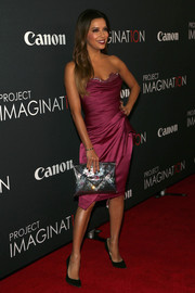 Eva Longoria completed her glam ensemble with a printed envelope clutch when she attended Canon's Project Imaginat10n Film Festival.