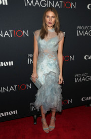 Dree Hemingway looked enchanting at the Project Imaginat10n Film Festival in a bluish-gray cocktail dress with a ruffled skirt.