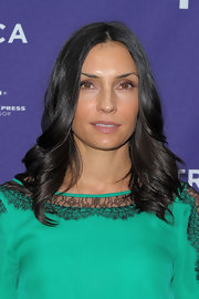 Actress Famke Janssen showed off her green lace dress, which she finished off with sleek center part curls.