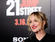 Dakota Johnson attended the premiere of '21 Jump Street' wearing her hair in a loose bun with wispy bangs and messy face-framing tendrils.