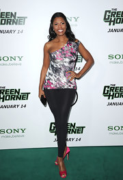 Omarosa dons a fluorescent top for this club-wear ensemble.