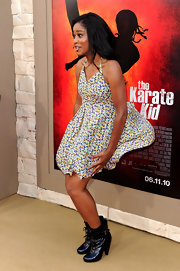 Woops! Keke must have felt a breeze. The actress paired her wind-battling sundress with patent lace up ankle boots.