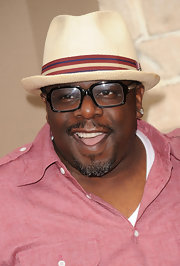 Cedric the Entertainer topped off his summery look with a cool straw hat.