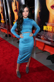 Jenna Ortega sealed off her look with a pair of sparkling mules.