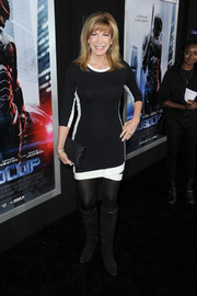 Leeza Gibbons chose a pair of knee-high black suede boots to pair with her mini.