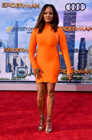 Garcelle Beauvais caught eyes in a bold orange bandage dress by House of CB at the premiere of 'Spider-Man: Homecoming.'