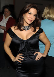 "Elena shows off her sparkling gemstone necklace at the ""Its complicated"" after party. Her necklace adds some nice interest to her otherwise typical black satin dress."